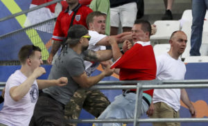 Clashes break out in the stands during the Euro 2016 Group B soccer match between England and Russia, at the Velodrome stadium in Marseille, France, Saturday, June 11, 2016. (AP Photo/Thanassis Stavrakis)